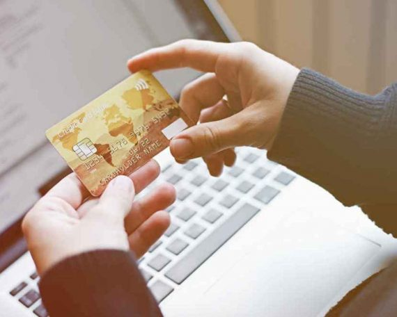woman-using-credit-card-for-online-purchase-PNNWZQD